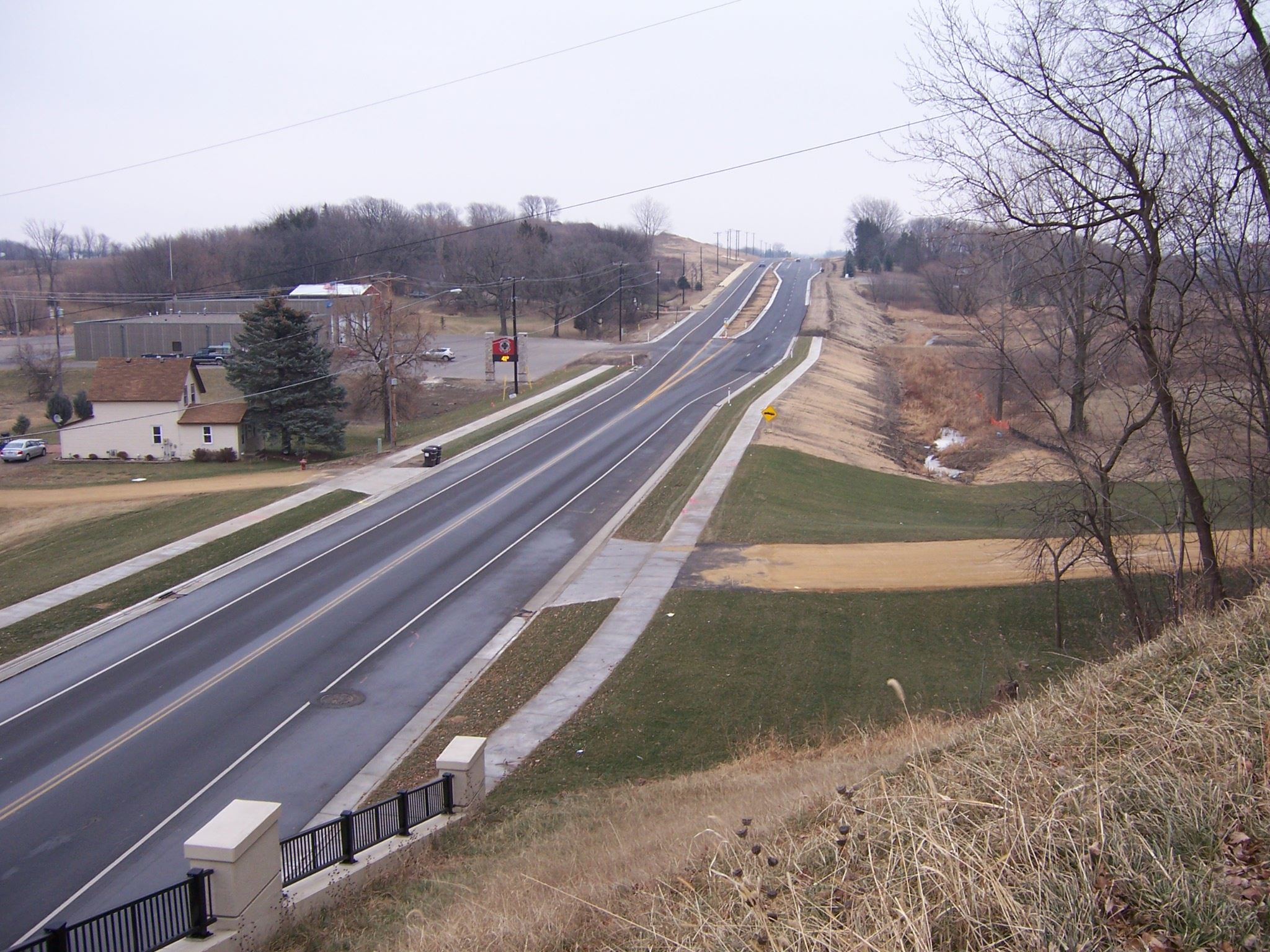 A highway stretches in Scott County on a gray day